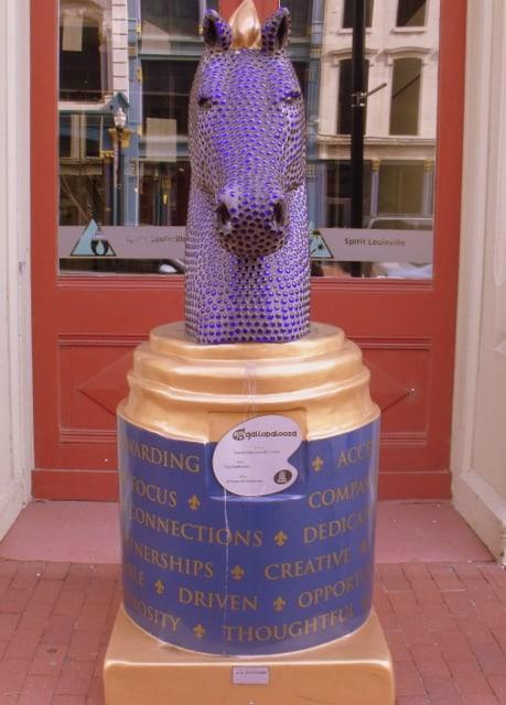 A purple studded statue of a horse head in Louisiville Kentucky