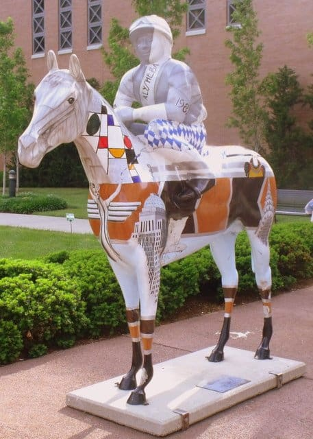 A downtown horse statue with jockey in Louisville Kentucky