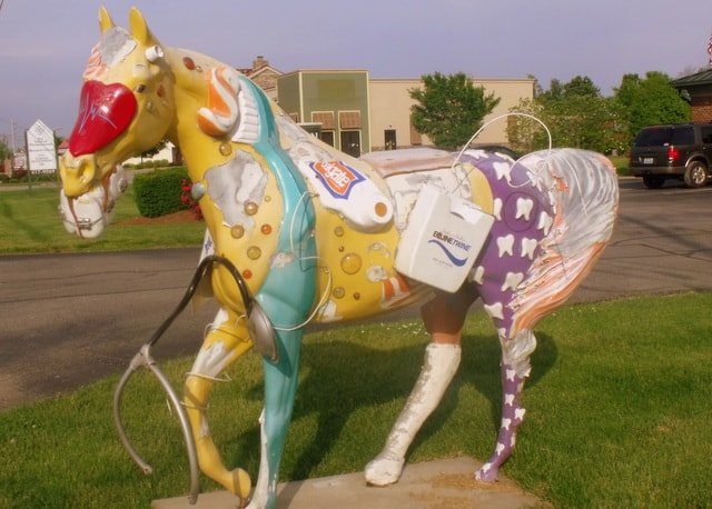 A horse statue with teeth and toothbrush theme