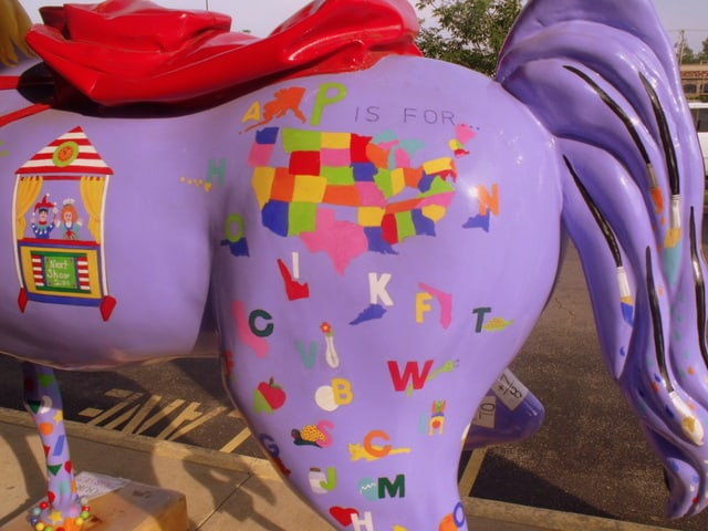 A map of America on a purple horse statue