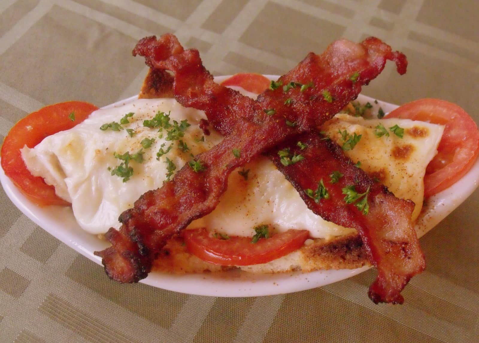 A single serving of a Kentucky Hot Brown Sandwich in a side dish