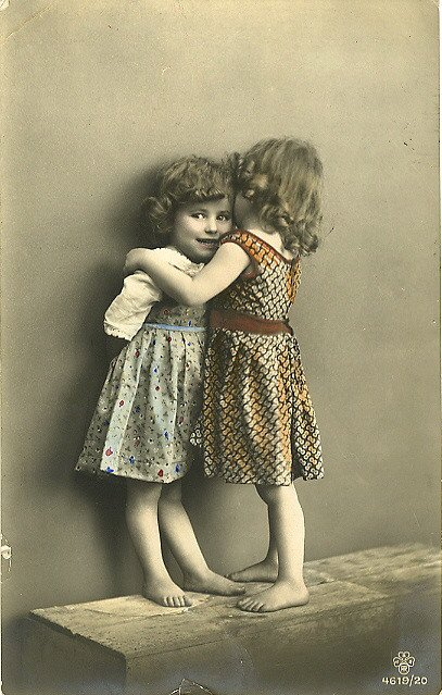Vintage photo of two little girls whispering