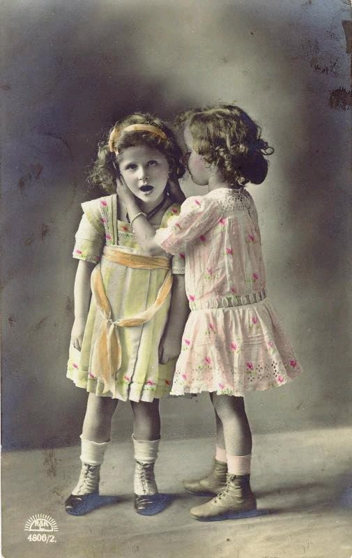 Victorian image of two girls whispering