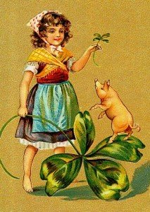 Irish girl with four leaf clover and a pig