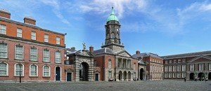 Red brick and spired buildings around the yard at Dublin Castle Ireland