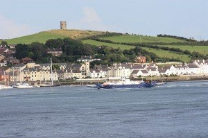 View of the Irish coastline in Strangford County Down with a ferry approaching the shore