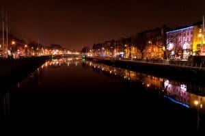 Illuminated buildings at night along the banks of the River Liffey in Dublin