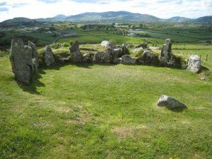 Ancient megalithic Irish stone tomb with standing stones in Ballymacdermot County Down