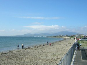 The beach at Newcastle looking to where the Mountains of Mourne sweep down to the sea