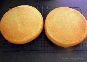 Two halves of a sponge cake cooling on a backing rack for an Irish sponge cake no butter recipe