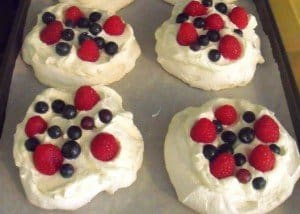 Mini pavlovas decorated with cream and berries