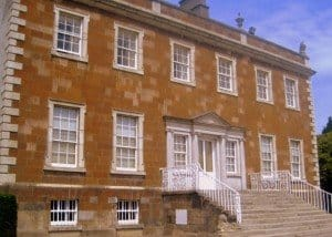 Frong view of Newbridge House with white front door and steps leading up to it