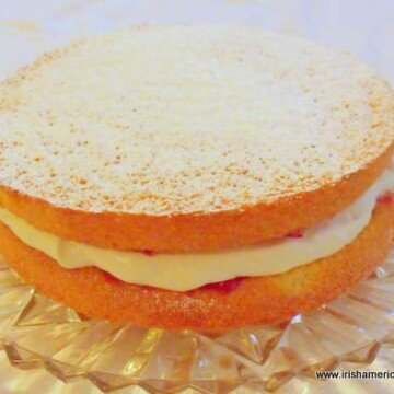 Cream and jam filled Irish sponge cake with a dusting of confectioner's or icing sugar
