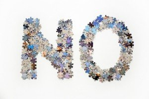 Puzzle pieces laid out to form the word NO
