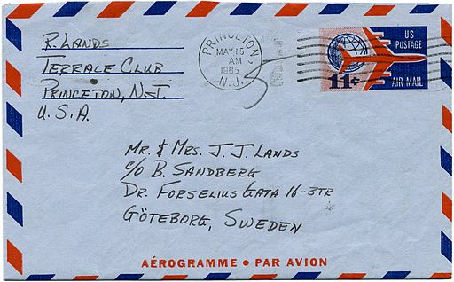 An addressed envelope with a red and blue border for an Aerogram