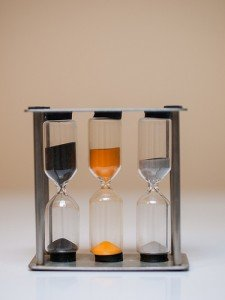 An egg timer with three different cylinders for soft medium and hard boiled eggs