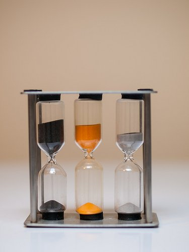 A triple egg timer with timers for hard, medium and soft boiled eggs