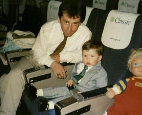 A father and son sitting on an airplane