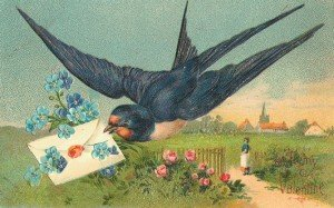A swallow holding a floral envelope in his mouth for Valentine's Day