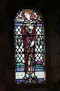Stained glass window in a church showing Saint Columcille of Donegal
