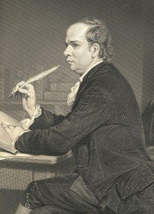 Oliver Goldsmith at a desk holding a quill