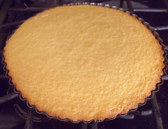 A golden brown sponge flan just baked and taken out of the oven.