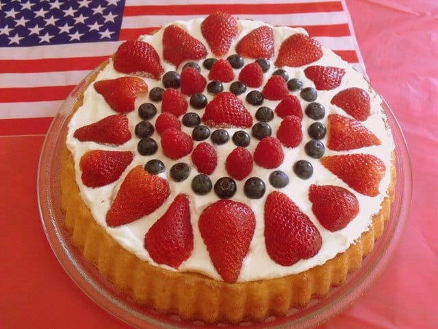 Strawberries and blueberries decorage and fruit and cream sponge