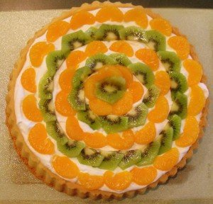 Circular pattern of fruit decorating and orange and green cake for Saint Patrick's Day