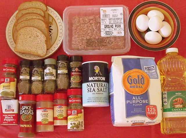 Ingredients for Scotch eggs including ground pork, bread, spices, flour, eggs and oil