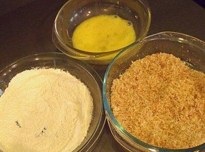 Three bowls with the ingredients for coating Scotch eggs