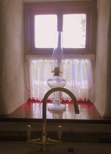 A sink sitting under a window