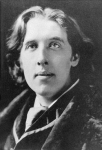 A face shot of Oscar Wilde in black and white
