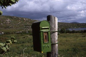 A small green post or mail box tied to a pole in County Donegal