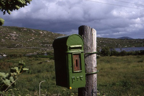 Green Irish post box attached to a post in County Donegal
