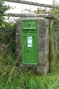 Green Irish post box from Edwardian times on a pillar in County Roscommon Ireland