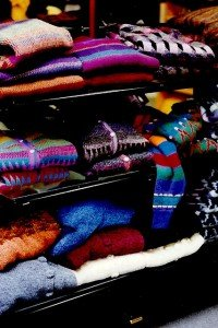 Colorful Irish sweaters on a store shelf in Galway Ireland