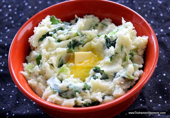A knob of butter melting in a bowl of Irish colcannon
