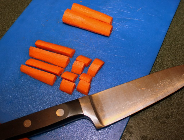 Carrot sticks being diced for carrot and coriander soup