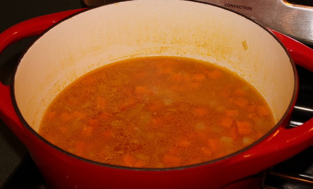 A pot of carrot and coriander soup in a pot before blending