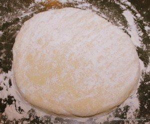 Potato cake dough on a floured surface for kneading