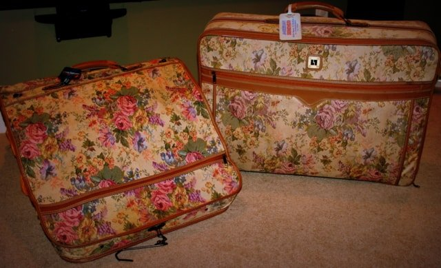 Two brocade floral or tapestry traveling luggage from the 1980\'s
