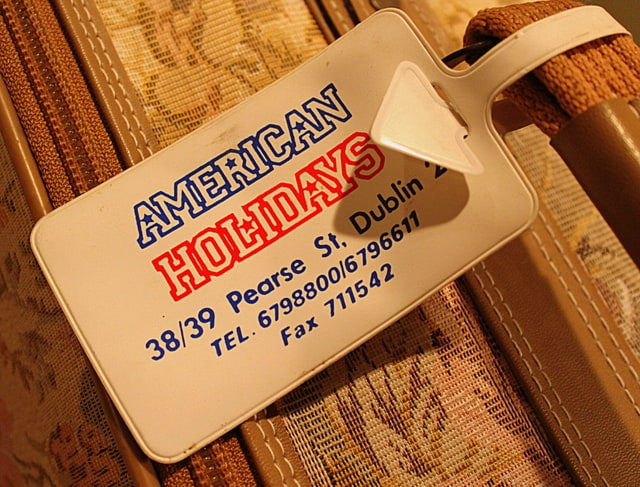 American Holidays Pearse Street Dublin luggage tag on a brocade suitcase from the 1980\'s