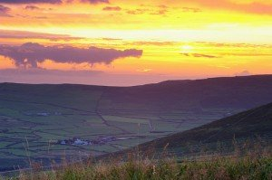 The sun setting over the fields on the Dingle Peninsula in County Kerry Ireland