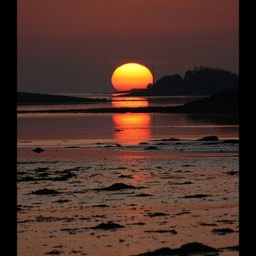 Mweeloon Bay in County Galway with the sun setting