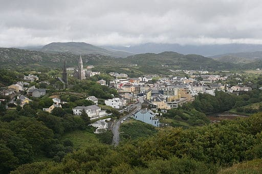 View of a town nestled in mountains and trees