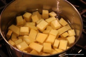 Rutabaga diced and in a saucepan of water