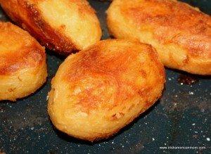 Crispy roast potatoes Irish style in a roasting pan
