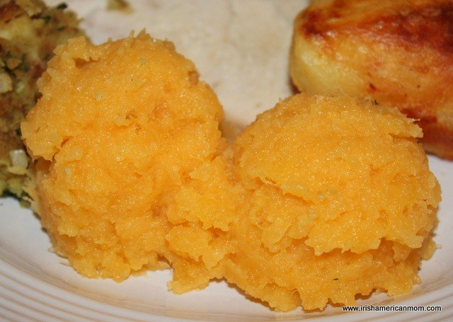 Yellow servings of mashed rutabaga for Thanksgiving dinner