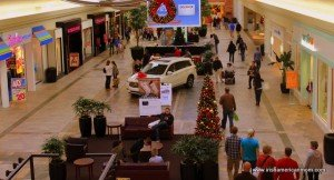 Christmas trees and shoppers in a mall in Kentucky