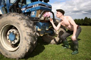 Irish farmer cleaning his tractor with a pink feather duster
